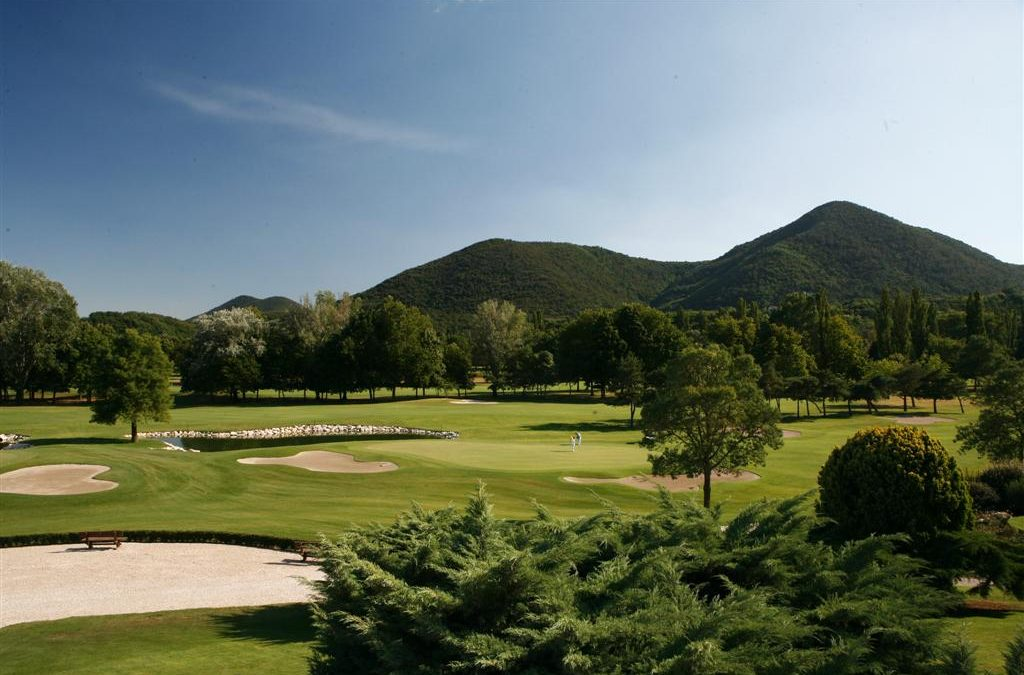 Summer golf, lost in the green of the Euganean Hills